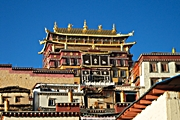 An opulent temple decorated with gold ornaments rises over Xianggelila's Songzanlin Monastery