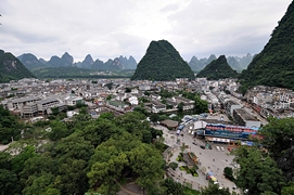 Downtown Yangshuo (阳朔), China, set amidst green karst hills
