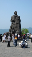 Tourists surround a large statue of He Long, a famous military leader, in Zhangjiajie (张家界), Hunan Province, China