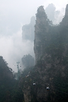 Gondolas (cable cars) ascend Tianzi Mountain through mist-shrouded karst peaks in Zhangjiajie (张家界), Hunan Province, China