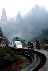 Tourists prepare to board a sightseeing train that passes through the karst (limestone) landscape of Zhangjiajie (张家界), Hunan Province, China
