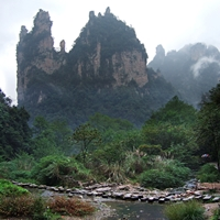 A stream flows beneath karst (limestone) peaks in Zhangjiajie (张家界), Hunan Province, China
